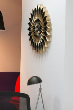 http://www.atakdesign.pl/pl/p/Sunflower-Clock/564