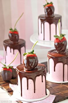 Chocolate-Covered Strawberry Cakes - with chocolate cake, fresh strawberry buttercream, and a rich chocolate glaze on top!