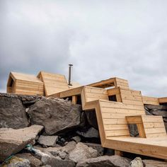 Students from the Oslo School of Architecture and Design designed and built a seaside sauna made up of wooden bands that stagger up over the rocky terrain