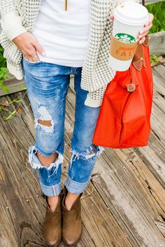 Distressed jean + ankle boot.