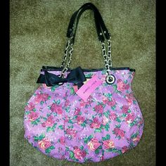 Betsey Johnson Floral Print Twinkle Toes Tote Super cute sequin and floral print Betsey Johnson tote bag. Black handle with gold accents. Zipper pocked on the inside. Snap closure. Rare to find. Brand new, with tags. Never used. No trades. Thank you for visiting my closet ?? Betsey Johnson Bags Totes