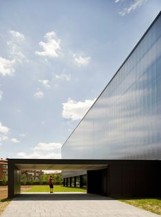 BCQ completes sports hall with translucent polycarbonate skin.