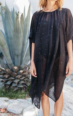 A best seller. This sheer button caftan looks gorgeous over a slip or undergarment where the handwoven elements can be seen. Perfect for cocktails.. The handwoven fabric is a Dhakai Jamdani weave whic