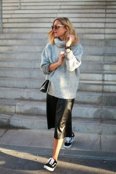 Adenorah killing it in a leather skirt, a cosy knit and vans. Laid back vibes.