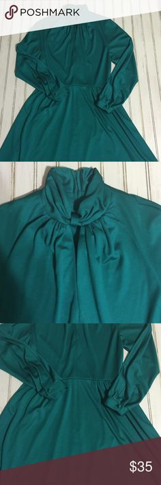 """Vintage Herman Marcus Dallas dress Beautiful shade of green.  High neck with a key hole opening.  Long sleeved with button cuffs.  Polyester blend material with spandex so it does have some stretch.  Hidden zipper in back.  No size tag but it would fit a size 8-12 so be sure to check measurements.  43.5"""" length, 13.5"""" waist, 15.6"""" bust.  Does have string belt loops but no belt. Herman Marcus Dresses Long Sleeve"""