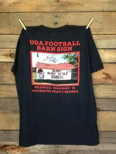 UGA Football Barn Sign Shirt Autographed by #34 Herschel Walker. Support First Love Kids with this Limited Edition Signature Series Tee.