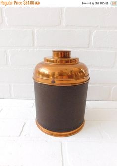 Vintage Copper Humidor   Measures 8 inches in height, and 5 3/4 inches in diameter.  The copper is t