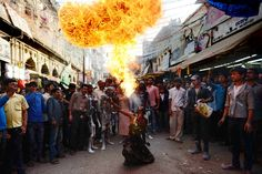An Indian Hindu devotee demonstrates his fire skills during a religious procession to mark the Hindu festival of Maha Shivratri in Allahabad