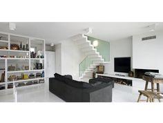 Treppe harmonisch in den Wohnraum eingebettet