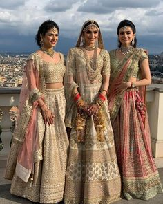 Indian Bride and brides sisters in Ivory Gold Sabyasachi Wedding Lehenga. Indian Bridal Outfits, Indian Bridal Fashion, Indian Bridal Wear, Indian Designer Outfits, Indian Designers, Indian Wear, Sabyasachi Wedding Lehenga, Indian Bridal Lehenga, Red Lehenga