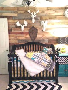Rustic Nursery with Wood Pallet Wall - love the faux taxidermy over the crib!