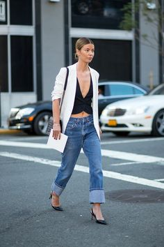 Oversized cuffs with a black crop top, white pinstripe blazer, leather slingbacks, and a low bun.