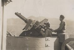 Allied gun crew during World War II | This image was scanned from a photograph…