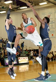 Woodside's Quincey Freeman shoots the ball under pressure form CD Hylton's Josh Peterson and Rashawn Sanders during the second half of their Showcase at the Wood game at Woodside Tuesday.