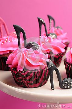 Female high heel stiletto shoes decorated pink and black red velvet cupcakes for teenage, female birthday, or wedding bridal shower