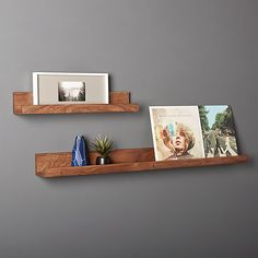 Shop Acacia Wall Ledge Warm acacia wood with upturned edges suspends photos, artwork and objects of interest. We love them staggered in the hall or greeting guests at the entry. Acacia Wall Ledges is a exclusive. White Wall Shelves, White Floating Shelves, Shelves In Bedroom, Wood Shelves, Wall Ledge, Frame Shelf, Home Decor Mirrors, Modern Shelving, Wall Mounted Shelves