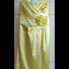 "Beautiful Satin Dress Sequin Hearts, size 9 juniors knee length tube dress. Beautiful light lime green (almost a yellow, photos are accurate) and ties in back. Never worn, tags attached. Flower is a pin that can be removed if you choose. I tend to ""save"" clothing for special occasions and unfortunately my body style no longer agrees with this gorgeous dress  Sequin Hearts Dresses Strapless"