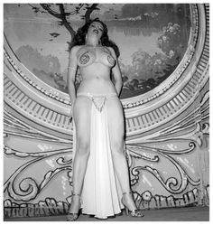 Tempest Storm Vintage 50's-era photo taken on stage at the 'FOLLIES Theatre' in Los Angeles, California..