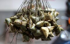 The most traditional food for the Dragon Boat Festival is Zong Zi, which is a glutinous rice ball, with different fillings, wrapped in bamboo leaves. The fillings can be egg, beans, dates, fruits, sweet potato, walnuts, mushrooms, meat, or a combination of them. The steamed Zong Zi is very delicious!