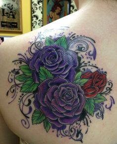 My 4th tattoo - beautiful purple and red roses, very bright and colorful. :) I love it!