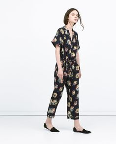 This Zara floral jumpsuit with collar is reminiscent of the beach pajamas worn by women in the 1930s. The typical suit had a colorful print, the top andd bottoms matched, and there was a collar and button down front closure. This style is a wrap closure, but it still has the original popular collar for beach pajamas. The influence is still clear despite minor design changes to the front closure and sleeves. Addy Forte 4/1