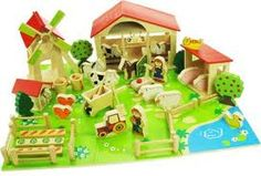 There s so much going on at this busy play farm which includes a stable windmill kennel pond and even a vegetable patch Join in the fun ! Christmas Presents, Christmas Ornaments, Wooden Playset, Farm Toys, Little Boy And Girl, Toys Online, Farm Yard, Wood Toys, Farm Animals