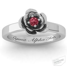 "Flourish Rose Ring. Red stone, engraved with ""Sigma Alpha Iota"""
