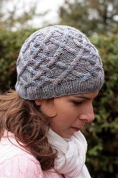 I designed this hat to celebrate our cold Canadian winters that allow us to sport lots of gorgeous hand knits. This beanie-style hat features lush, all-over cables that make for a warm and cushy fabric. The decreases are integrated into the cabled motif to create a lovely flower shape at the crown.