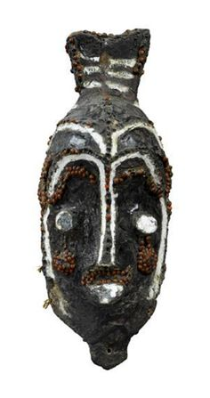 Africa | Mask from the Luluwa people of DR Congo | Wood, pigment, resin, abrus seeds and kaolin | Early 1960s