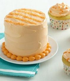 This two-layered mini-round cake with pastel frosting and bright orange stripes is sure to get baby's attention! Decorate the accompanying cupcakes with polka-dot sprinkles in orange (or a complementary color like blue or white) for a nice contrast.