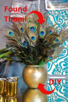 Peacock bathroom decor ideas - peacock feathers in a gold vase sitting on the counter adds elegance to the bathroom - great diy idea!