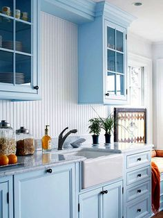 soft blue kitchen cabinets with wainscoting backsplash