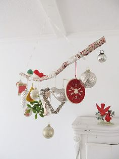 A joyful branch...  Love this idea.  It is sort of like the rod at the back of my Wash Stand...I hang glass balls I have gotten thru the years on the towel rod.  This one can be hung like a mobile!