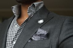A simple gray pocket square can go with anything.