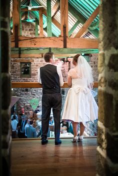 Holly wears a custom 50s wedding dress by Lizzie Jayne with a rainbow petticoat.
