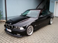 E36 in black but four door