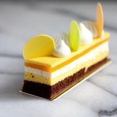 July 17 2017。Hong Kong。Dessert。Mango Opera Cake  Love the layers n it looks so fashionable!! So, it's fashionably delicious!! #beautifulcuisines #simplisticfood #gastronogram #feedfeed #cuisine_captures #chefsroll #topcitybites #foodamology #eniyilerikesfet #aroii #gastroart #foodblogger #foodblog #nom #nomnom #vscofood #menwithcuisines #ケーキ #デザート #디저트 #相機食先 #chefsplateform #맛있는  #hkfoodie #breakfast #美味しい #foodart #comfortfood #gourmet #hongkong .