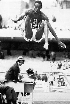 Bob Beamon long jumps 29′ 2 1/2 inches to shatter the world record by more than two feet at the 1968 Olympics. When re realized how far he jumped, he fell to the ground in shock.  His world record held for 23 years and he STILL holds the Olympic record in 2012.