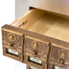 I have some of the old post office box doors and have been trying to think of how to use them....PO Box drawer front