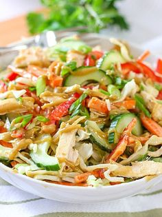 Crunchy Thai Chicken Salad With Peanut Dressing With Dressing, Creamy Peanut Butter, Rice Vinegar, Lime, Vegetable Oil, Sesame Oil, Soy Sauce, Honey, Sugar, Garlic Cloves, Fresh Ginger, Salt, Crushed Red Pepper Flakes, Cilantro Leaves, Salad, Chicken, Cabbage, Carrots, English Cucumber, Red Pepper, Green Onions, Peanuts