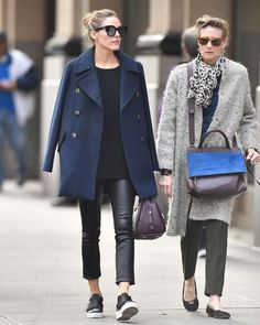 Olivia Palermo - leather jeans and black sweater with navy coat; Max & Co Bag