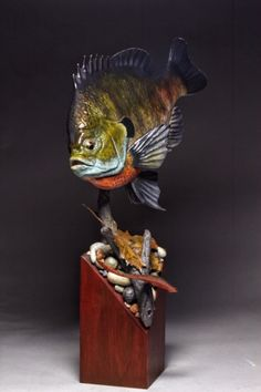 Hand carved and painted Bluegill male. Branch, eyes, rocks, leaf and leech also hand carved and painted. Yves Laurent 2020 Yves Laurent, How To Antique Wood, Whales, Hand Carved, Rocks, Carving, Birds, Fish, Eyes