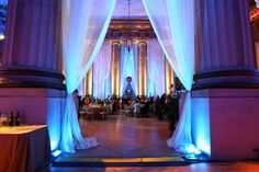 Drapes of sheer fabric softened the columned space.