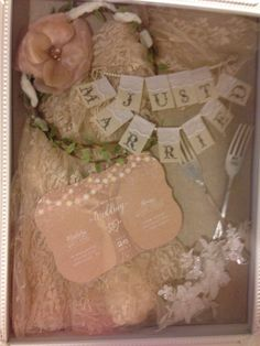 Making a wedding keepsake: I took some leftover lace and made it part of the background and incorporated my headpiece, garter, cake topper, invitation, and some cute forks we used! Really simple, just buy a shadow box (: Wedding Keepsakes, Forks, Garter, Shadow Box, Got Married, Save The Date, Headpiece, Cake Toppers, Gift Wrapping