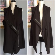 ✨Listing✨Rafaella Chic Zippered Fashion Vest You will LOVE this amazing rich black sturdy fashion vest from Rafaella !!  Wear open , partially/fully zippered ... lots of options and all so very chic & fashionable !  Made of 64% polyester/31% rayon/5% spandex .  Machine wash/dry .  ✨I have two available so please ask for a separate listing when ready to purchase✨ This is a size 18W Rafaella Tops