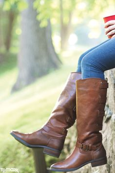 Every woman needs: Chestnut brown riding boots. The style is jeans-to-dresses versatile and works in rain, shine or snow.