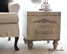 This is the best yet -- it was an old ratty ottoman that she turned into this great sidetable!!