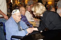 Belmont Village Sabre Springs Veterans Pinning Ceremony on Nov. 28. Two Pearl Harbor Veterans were in attendance as were two veterans that served in Iraq who did the pinning.