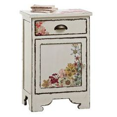 Provencal charm defines the delightfully illustrated Floral Accent Cabinet, complete with a generously sized drawer for stowing media accessories, nighttime essentials, or toiletries in the guest bathroom. Vibrant blossoms adorn its distressed antique white finish, offering lush romanticism for everyday life.   Product: Accent cabinet   Construction Material: Wood and MDF   Color: Off-white