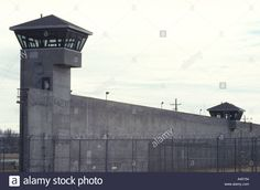 Download this stock image: Prison tower and wall. The towers are manned by armed guards 24/7. Towers are only accessible from the outside. State prison. - A45154 from Alamy's library of millions of high resolution stock photos, illustrations and vectors.